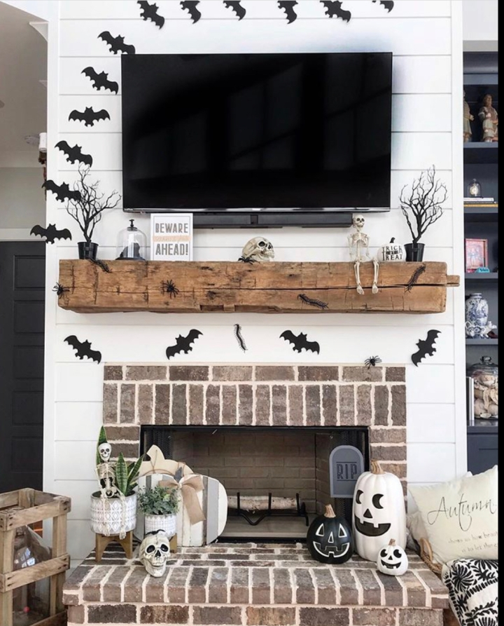 Halloween decor trends flying paper bats Halloween mantle inspo