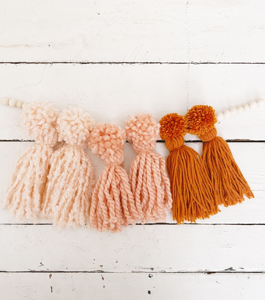 Pom Pom tassel garland how to make a Pom Pom tassel boho garland